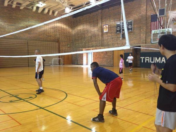 A student gets ready for a set while waiting for a serve from his teammate at the staff/faculty versus student match on Sept. 30. Photo courtesy of Truman Volleyball Club