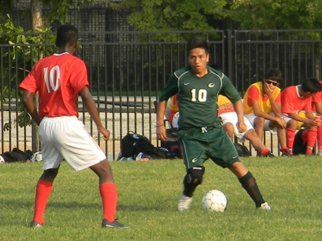 Christian Pacheco maneuvers past a Malcolm X defender. Photo credit: Todd Thomas.