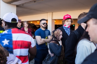 People began to suspect undercover protesters were in line because of the amount of diverse people in it compared to other Trump rallies.
